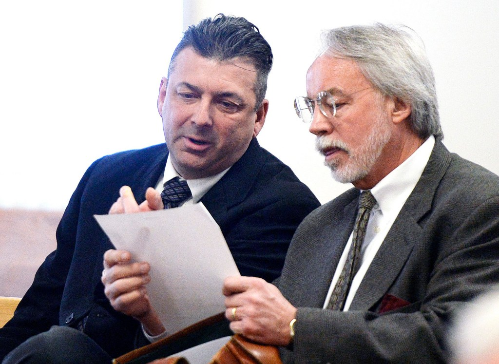 """Thomas Fortier, left, seen in court with his attorney Bruce Merrill in March, testified during his theft trial that it's """"not for me to say"""" whether two teenagers lied when they said he told them to charge for parking at a town-owned lot on July 4, 2016."""