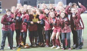 THE RICHMOND GIRLS soccer team celebrates with the Gold Ball after defeating Ashland, 2-1, in the State Class D final on Saturday at Hampden Academy. Story, page B1.