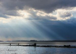 CLAMMERS on Maquoit Bay start to pack up before an approaching gale Wednesday afternoon.