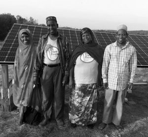FARMERS from New Roots Cooperative Farm.