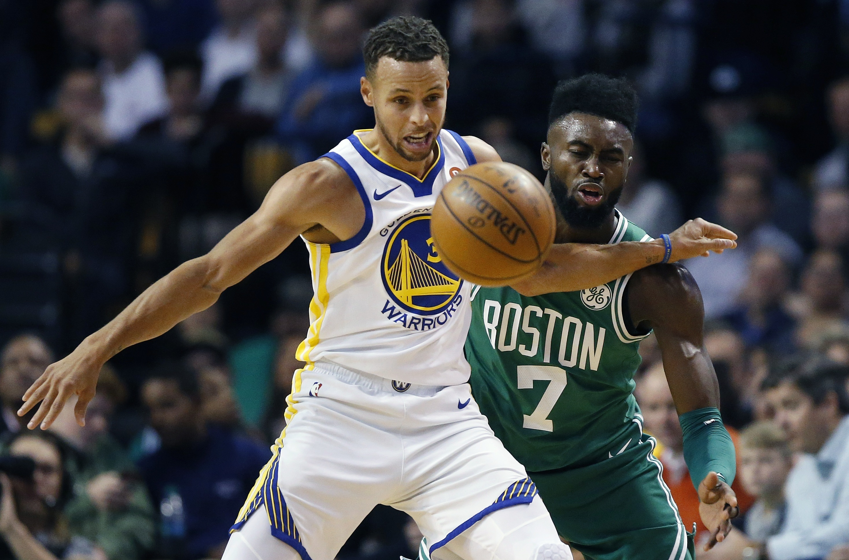 Boston Celtics' Jaylen Brown, right, and Golden State Warriors' Stephen Curry, left, battle for a loose ball during the first quarter of an NBA basketball game in Boston, Thursday, Nov. 16, 2017. AP NEWSWIRE