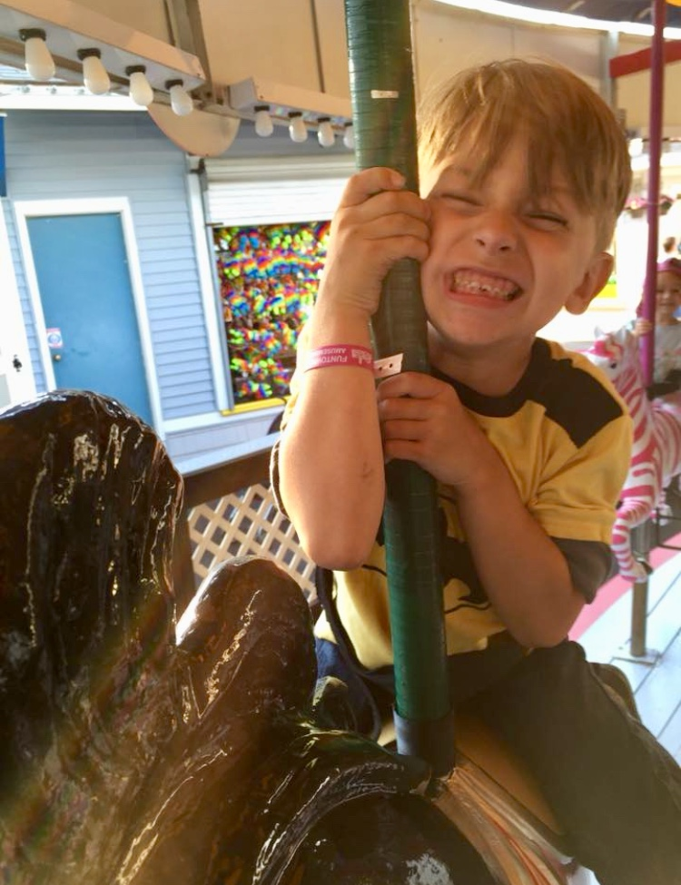 Brock Chadwick, 7, enjoys himself on a carousel. The Biddeford boy died Sunday. COURTESY PHOTO/Facebook