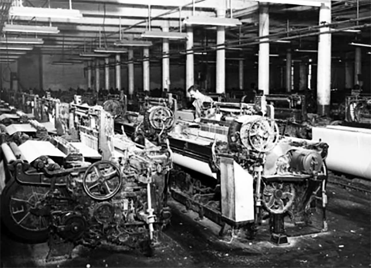 A laborer works on a machine at the Pepperell Mill in 1953 in Biddeford. COURTESY PHOTO/Biddeford Historical Society