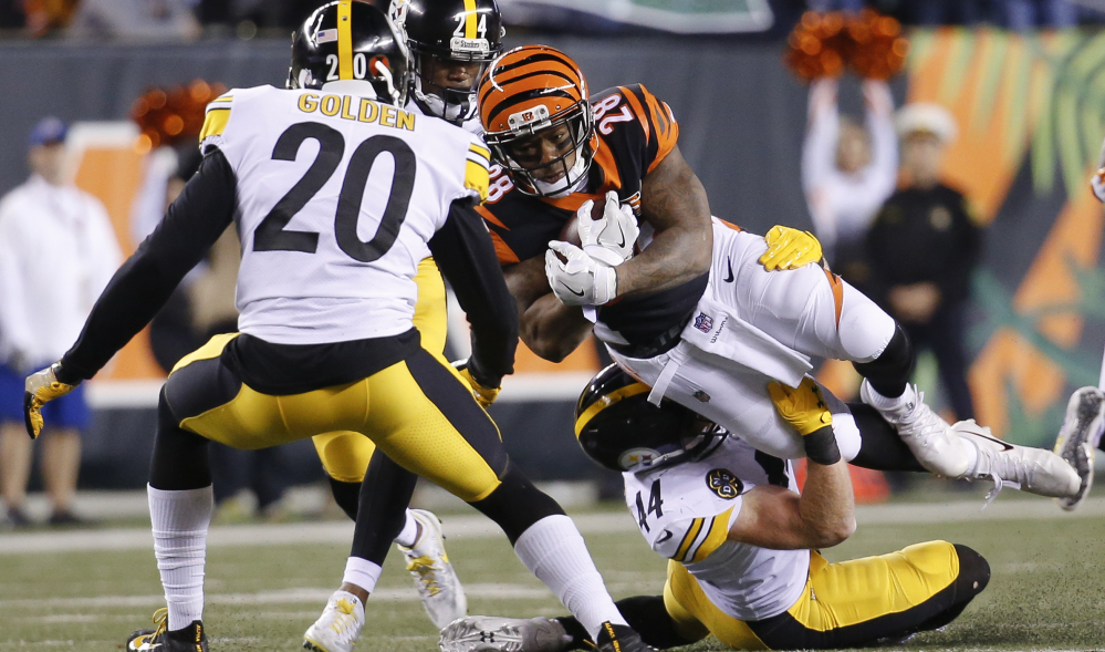 Bengals running back Joe Mixon is tackled by Steelers linebacker Tyler Matakevich during the first half Monday night in Cincinnati.