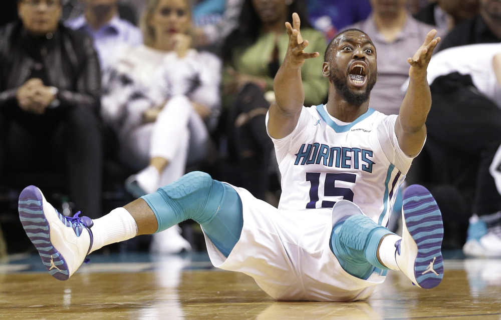 Charlotte's Kemba Walker argues for a foul during the Hornets' 104-94 win over the Magic on Monday in Charlotte, North Carolina. Walker scored 29 points in his return from a shoulder injury.