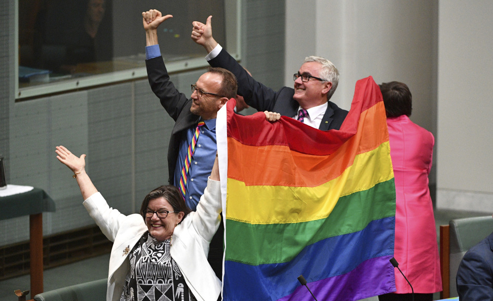 """Parliament members celebrate the nearly unanimous passing of the Marriage Amendment Bill in Canberra, Australia. """"I think this is so wonderful,"""" said Prime Minister Malcolm Turnbull."""