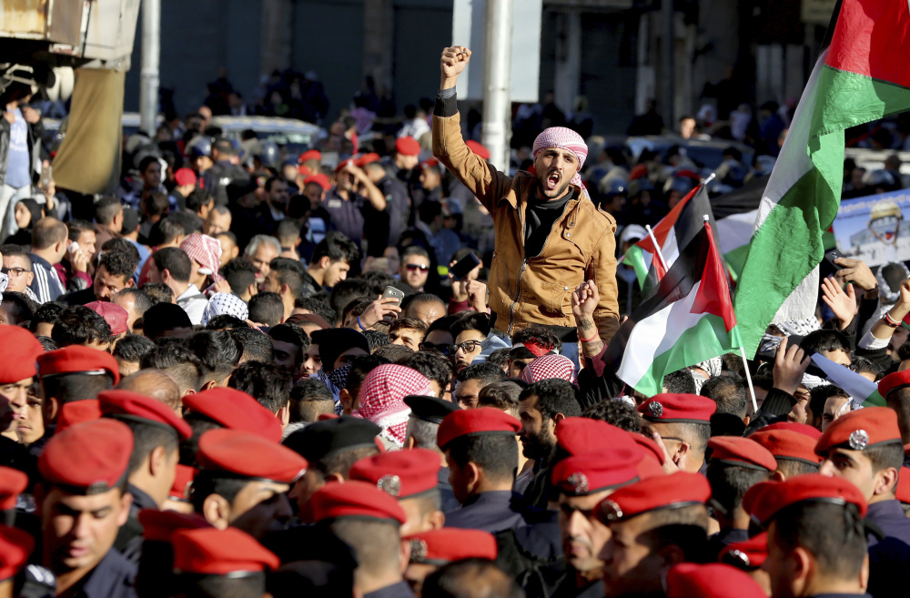 Protesters shout during a protest Friday in Amman, Jordan, after President Trump's decision to recognize Jerusalem as the capital of Israel. Pro-Western Jordan is a crucial U.S. ally in the fight against Islamic extremists, but King Abdullah II cannot afford to be seen as soft on Jerusalem.