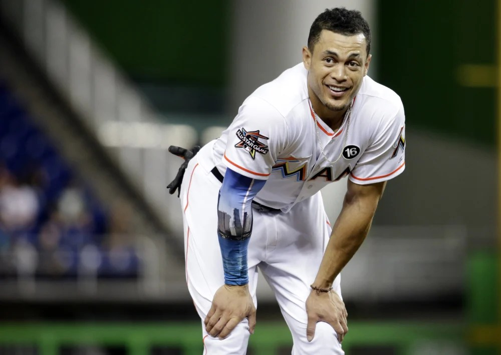 A person familiar with the negotiations says the New York Yankees and Miami Marlins are working on a trade that would send slugger Giancarlo Stanton to New York.