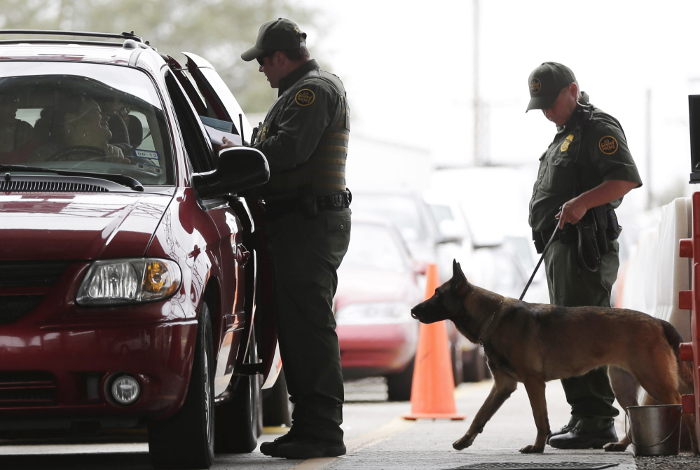 """U.S. Customs and Border Patrol agents at a checkpoint station in Falfurrias, Texas. President Trump says he wants to make legal immigration a """"merit-based"""" system."""