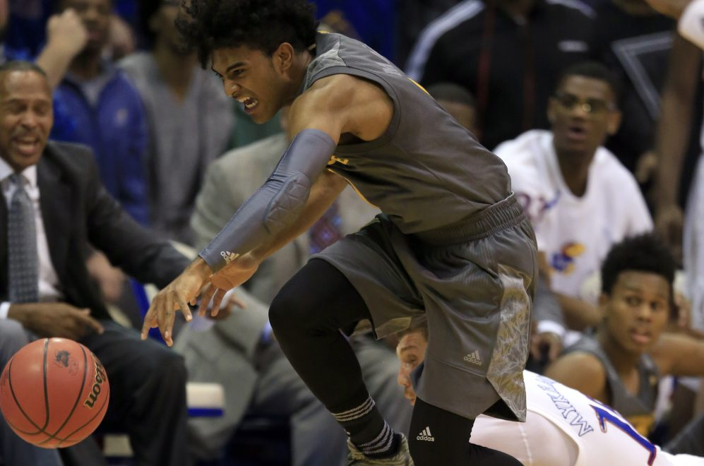 Arizona State guard Remy Martin, top, steals the ball from Kansas guard Sviatoslav Mykhailiuk, bottom, during the Sun Devils' 95-86 win Sunday in Lawrence, Kansas. It was the second straight loss for the Jayhawks.