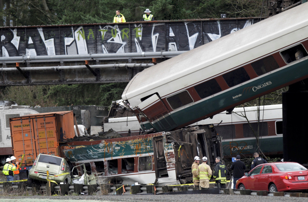 Responders work the scene of the Amtrak derailment in DuPont, Wash. Rescue crews had to use chain saws, hydraulic equipment, air chisels and various other tools to extricate victims.