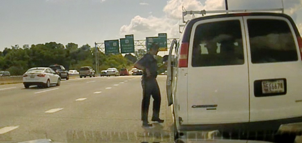 In a photo taken from Maine State Police Trooper Robert Burke III's video dash camera, he talks to the driver of a van on I-295 on Sept. 9. Though Burke said he'd pulled over the van for a cracked windshield, his attention quickly turned to the immigration status of those inside.