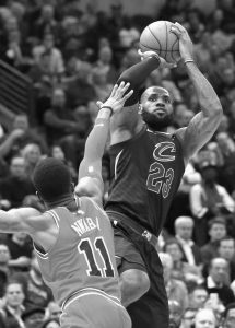 CLEVELAND'S LeBron James, right, shoots over Chicago Bulls' David Nwaba during the first half of an NBA basketball game Monday in Chicago.