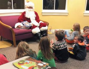 SANTA CLAUS will be visiting Topsham Public Library on three occasions this month: On Wednesday, Dec. 13, at 10 a.m., the library will host story time with Santa. Cameras welcome. On Thursday, Dec. 14, from 6-7 p.m. and Saturday, Dec. 16 from 1:30-2:30 p.m. the library will host Santa Reads, sponsored by Priority Real Estate Group LLC. Santa will be at the library to read to children in grades k-5, and to give out award-winning children's books. Children will also be able to bring a book home. For more information, call Topsham Public Library at (207) 725-1727 or visit topshamlibrary.org.