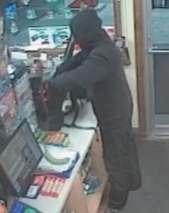 A MALE SUSPECT, as seen in this still from a security camera, dressed in black, is alleged to have gotten away with an undisclosed amount of money from a Lisbon convenience store.