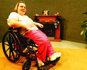 Ashley Gray of Biddeford has overcome the challenges of cerebral palsy to become the host of her own television show on the city's public access channel and inspire others faced with physical disabilities. ED PIERCE/JOurnal Tribune