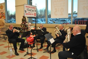 A brass ensemble from the Old Orchard Beach Salvation Army plays at the Market Basket grocery store in Biddeford on Thursday. LIZ GOTTHELF/Journal Tribune