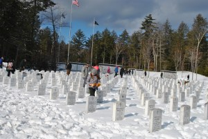 Wreaths were laid on the graves of veterans on Wreaths Across America day at the Southern Maine Veterans' Cemetery in Springvale on Saturday. A girl and others look at the headstones prior to the ceremony. DINA MENDROS/Journal Tribune