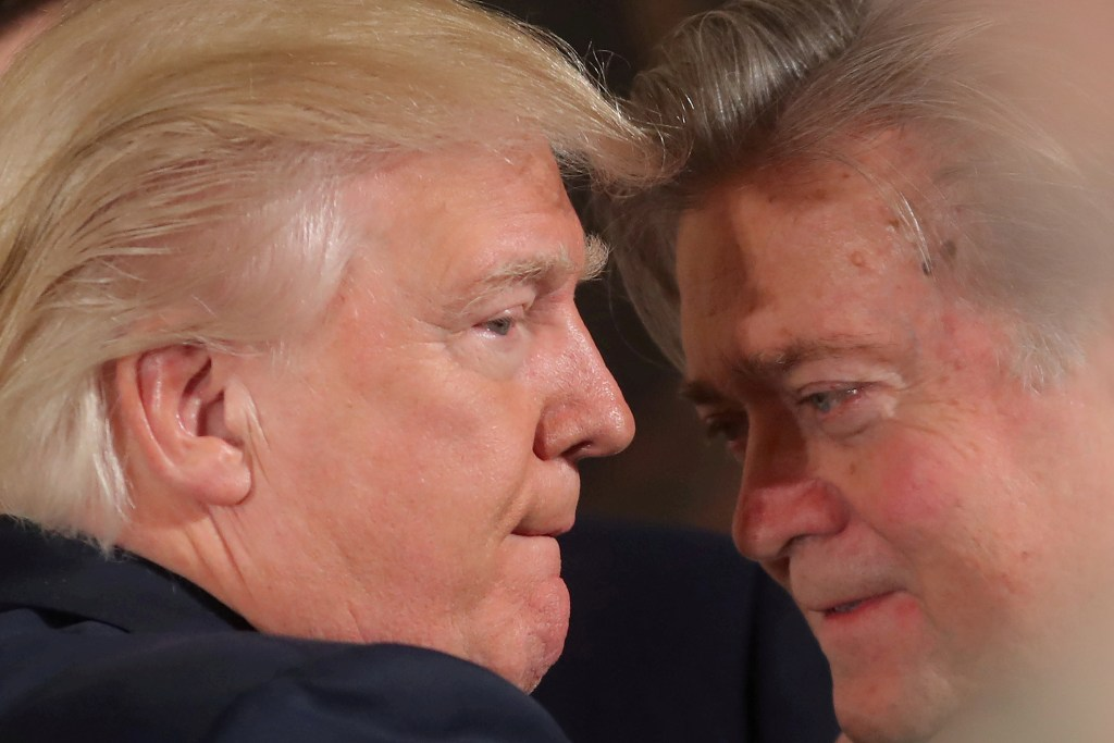 President Trump talks to then-chief strategist Steve Bannon during a swearing in ceremony for senior staff at the White House on Jan. 22, 2017.