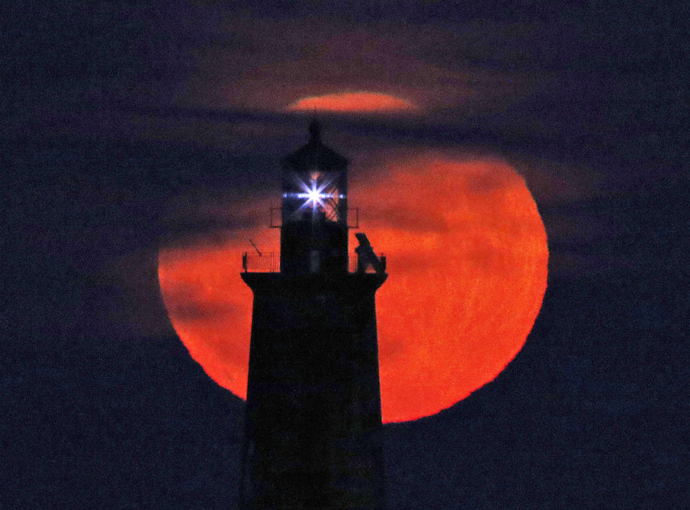 The only supermoon of 2017, shown rising behind Ram Island Ledge Light in Cape Elizabeth Sunday evening, reached its perigee at 3:45 a.m. Monday, witnessed perhaps by just a few night owls. But there will be two supermoons in January.