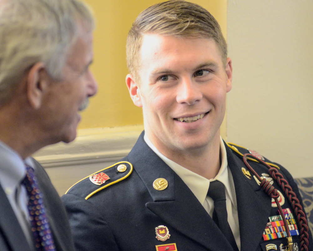 """Sen. Roger Katz, R-Augusta, left, chats with Staff Sgt. Ryan McCarthy before the session on Wednesday at the State House in Augusta. McCarthy along with family and friends were there so that he could receive joint legislative sentiment congratulating him recently winning the <a href=""""http://www.pressherald.com/2017/1 7/mainer-wins-armys-top-nco-award/"""">Non Commissioned Officer of the Year award</a>. McCarthy grew up in Belgrade."""