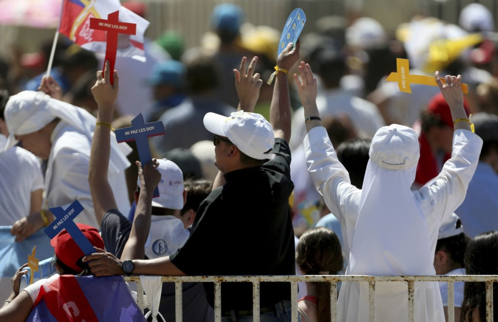 Nuns and a priest celebrate during a meeting of Pope Francis with young people Wednesday at the Shrine of Maipu in Santiago, Chile.