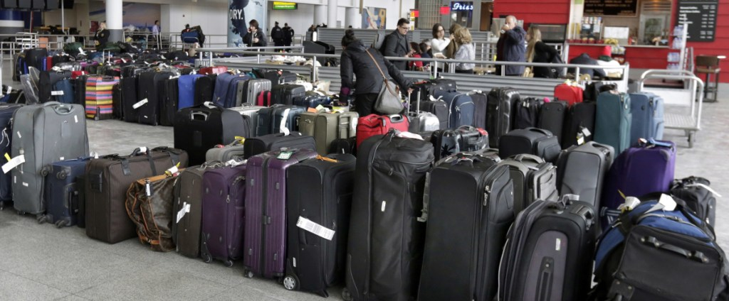 Unclaimed baggage sits at New York's John F. Kennedy Airport on Jan. 8 after a water pipe burst after days of weather-related delays in the wake of a snowstorm.