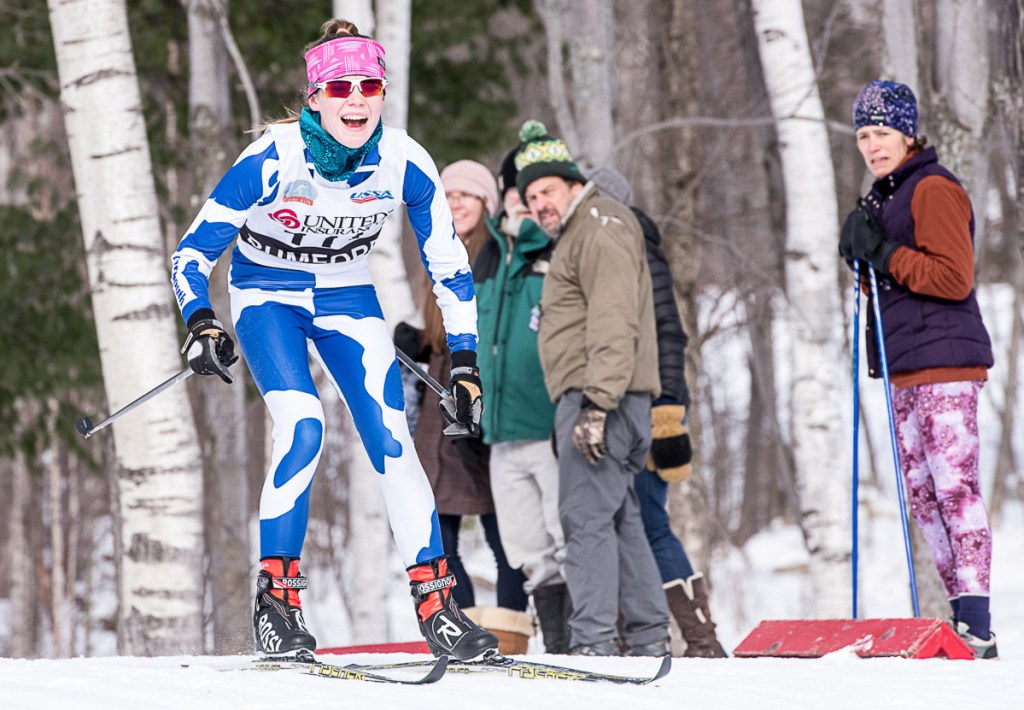 Natalie Teare of Yarmouth reacts while approaching the final downhill stretch during the Sassi Memorial on Saturday at Black Mountain in Rumford. Teare placed 30th overall with a time of 18:37.8.