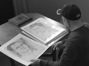 "WORLD WAR II VETERAN WILFRED ""SPIKE"" MAILLOUX looks through a series of sketches of U.S. Army 27th Infantry Division soldiers while visiting the New York State Military Museum and Veterans Research Center in Saratoga Springs, N.Y, in this Dec. 8, 2017 photo. They were done in Hawaii by Stan Dube in 1943, a year before the 27th Division fought in the Battle of Saipan. Now his son, Ira Dube, is hoping to identify the men, so he has donated his late father'Äôs 15 sketches to the museum."