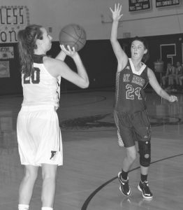 FREEPORT'S CAROLINE SMITH (20) looks to the basket as Mt. Ararat defender Caitlyn Smith (24) closes in. The Falcons defeated the Eagles, 53-39.