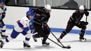MT. ARARAT/LISBON/MORSE defenseman Jacob Sargent (13) pressures Greely's Owen O'Connell (9) during a boys high school hockey game at Bowdoin College's Sidney J. Watson Arena on Wednesday. Looking on is Rangers forward Peter Lattanzi (17). The host Eagles fell, 7-2.