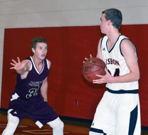 RICHMOND AND LISBON met in boys and girls basketball action over the weekend. In the photo at the top of the page, Bobcat Dan Stewart (32) guards Lisbon's Sean Scott, while above Richmond forward Bryanne Lancaster (20) moves in on Greyhound Charlee Cox. See game stories on B1.