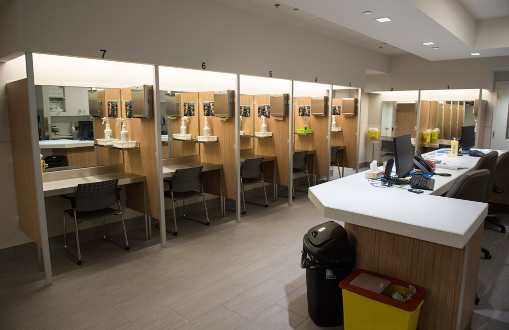 """Booths line the Cactus """"safe injection site,"""" where drug addicts can shoot up using clean needles, get medical supervision and freedom from arrest, in July in Montreal. The sites are one strategy used in Canada as it tries to counter the high rate of overdose deaths."""