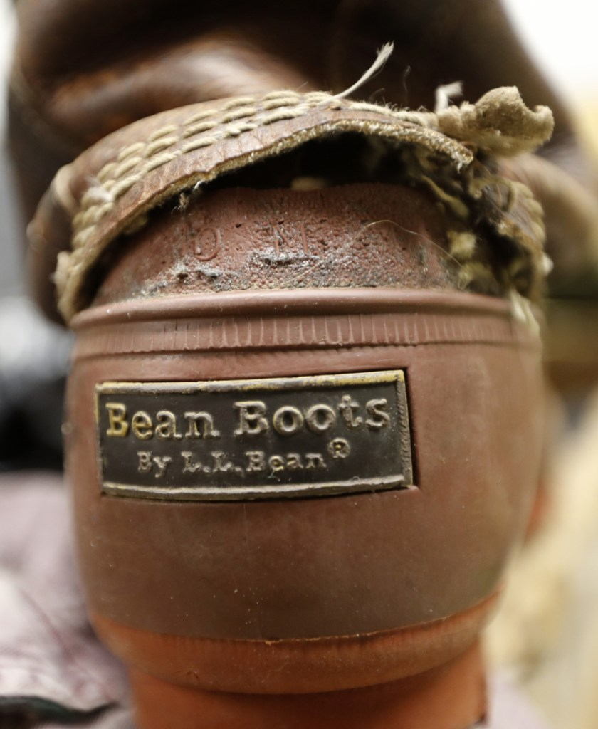 L.L. Bean says it will always accept retuns on products that have failed, such as this boot in the company's return bin in Freeport.