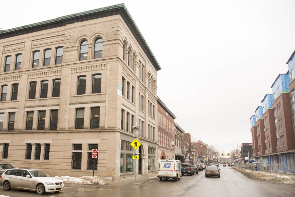 The Portland Pie Co. has signed a lease with Colby College to occupy ground floor space in the Hains Building, on the left, at the corner of Main and Appleton streets and across Main Street from Colby's new residential complex, seen under construction on the right.