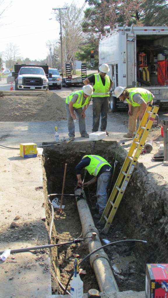Employees from ETTI, a utilities construction company, work on a Summit Natural Gas line in May 2015 in Waterville to replace a part that had been incorrectly installed. Summit says it will break ground this spring on a project to expand its services and infrastructure to Sidney after striking a deal with asphalt and aggregate materials producer Pike Industries.