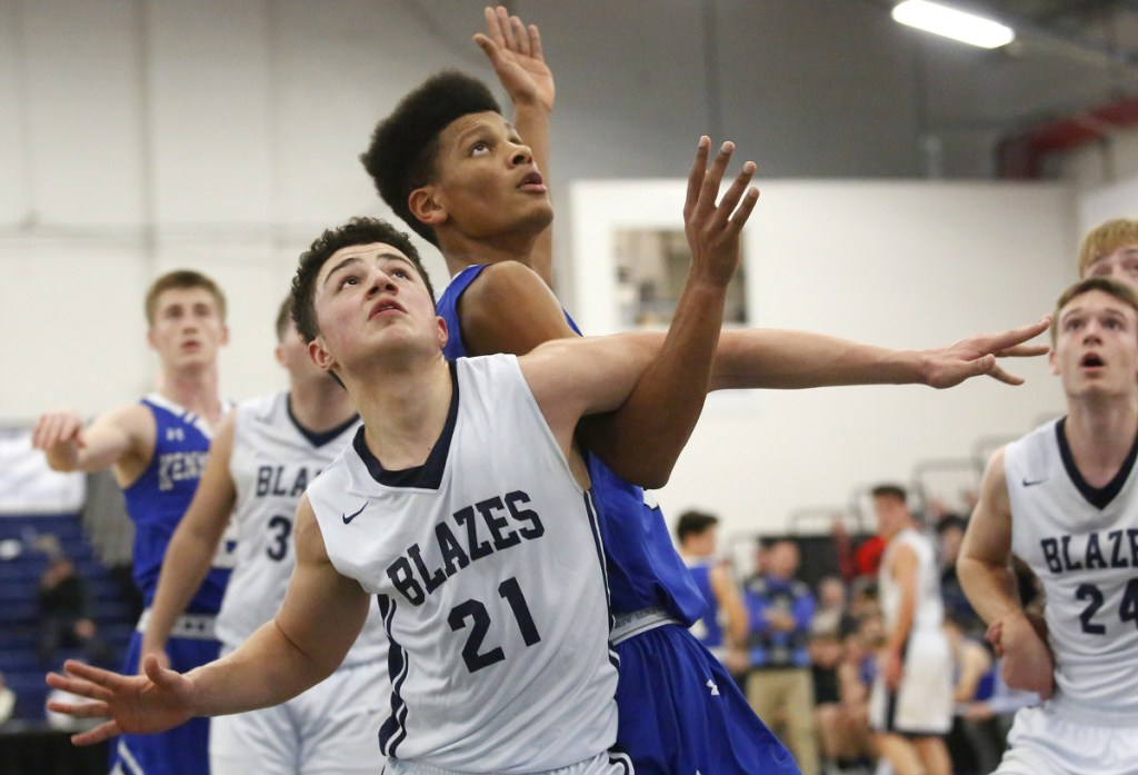 Jeremiah Alado, left, of Westbrook and Max Murray of Kennebunk fight for rebounding position during a Class A South basketball quarterfinal Saturday night at the Expo. Westbrook, the No. 3 seed, advanced with a 53-32 victory.