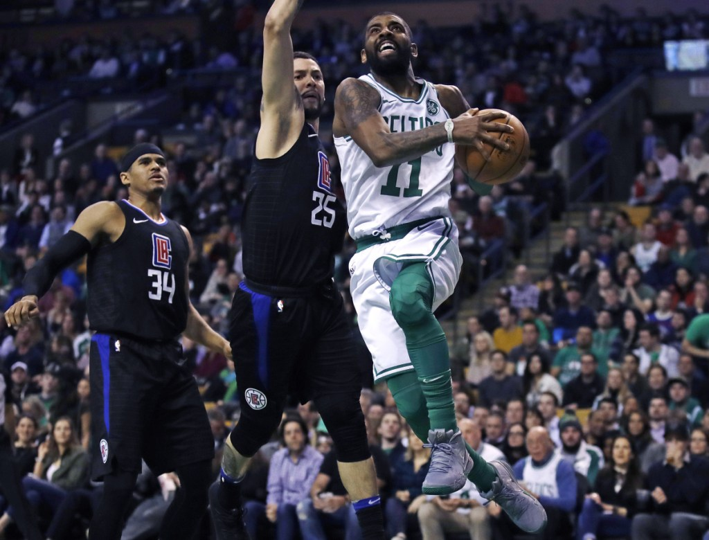 Kyrie Irving, right, drives to the hoop during the Celtics' 129-119 loss to the Clippers on Wednesday. Boston is just 5-4 since facing the Golden State Warriors on Jan. 27.