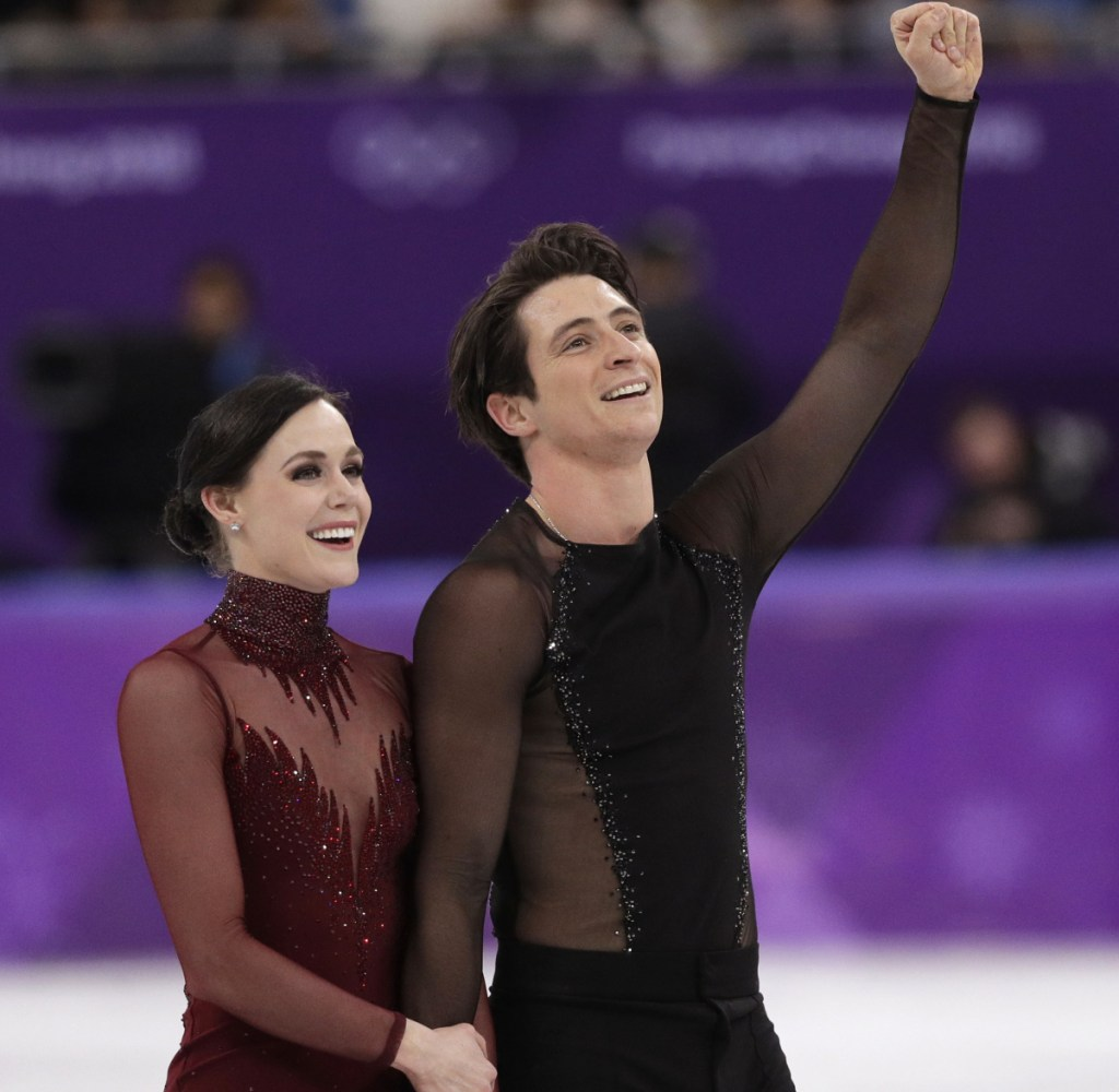 Tessa Virtue and Scott Moir of Canada react as they leave the ice following their performance in the ice dance, free skate final Tuesday. Virue and Moir won the gold in their final Olympic performance.