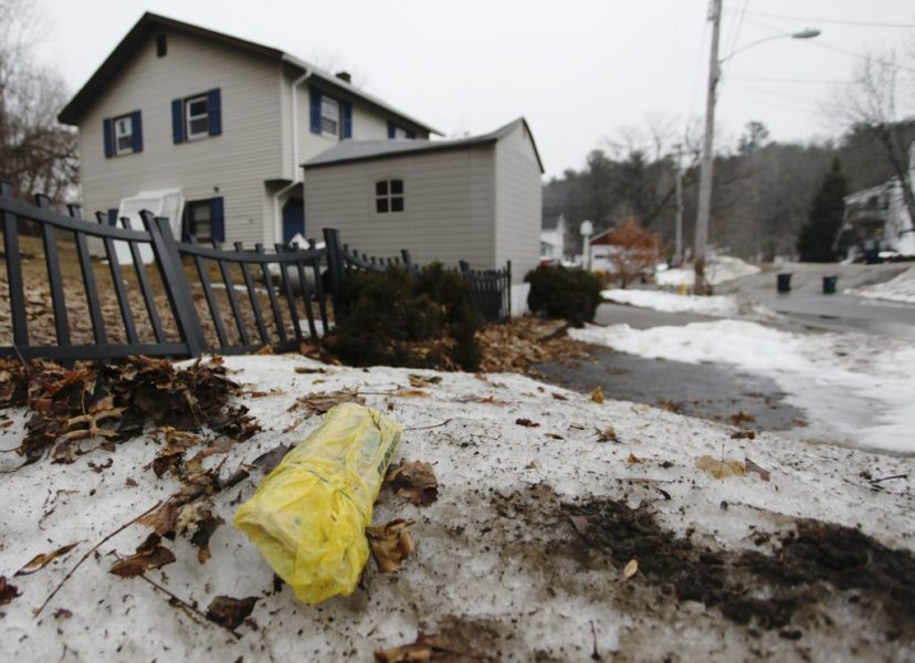 Newspapers take Biddeford to court over effort to curb deliveries of     A plastic wrapped newspaper lies uncollected in an Acorn Street yard in  Biddeford  A