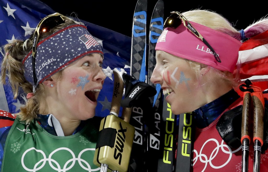 Jessica Diggins, left, and Kikkan Randall of Team USA celebrate after winning the gold medal in the women's team sprint freestyle cross-country skiing on Wednesday.