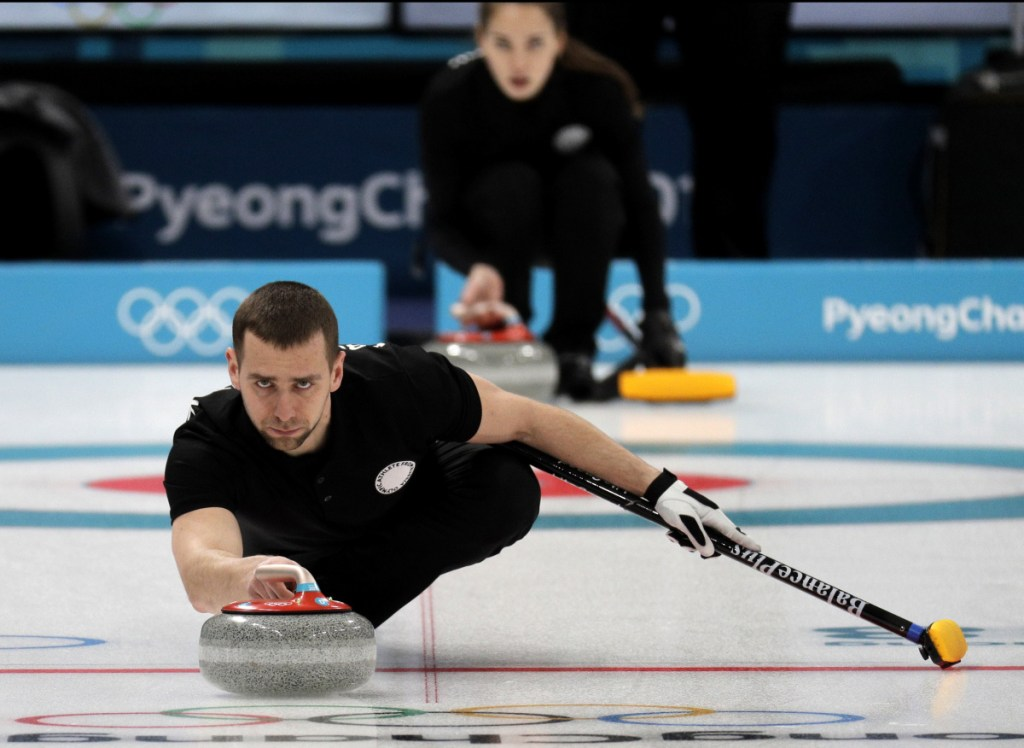 Russian curler Alexander Krushelnitsky practices ahead of the 2018 Winter Olympics in Gangneung, South Korea. Russian curlers say a coach on their team told them that mixed doubles bronze medalist Krushelnitsky tested positive for a banned substance at the Pyeongchang Olympics.