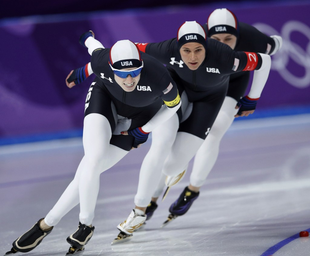 Team USA, with Heather Bergsma, rear, Brittany Bowe, center, and Mia Manganello, front, compete in the women's team pursuit speedskating event in South Korea on Wednesday. They won a bronze medal.