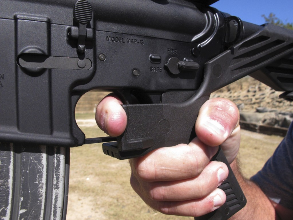 One reader wants to ban sales of military-style weapons like this AR-15 fitted with a bump stock, and another wants to arm teachers.