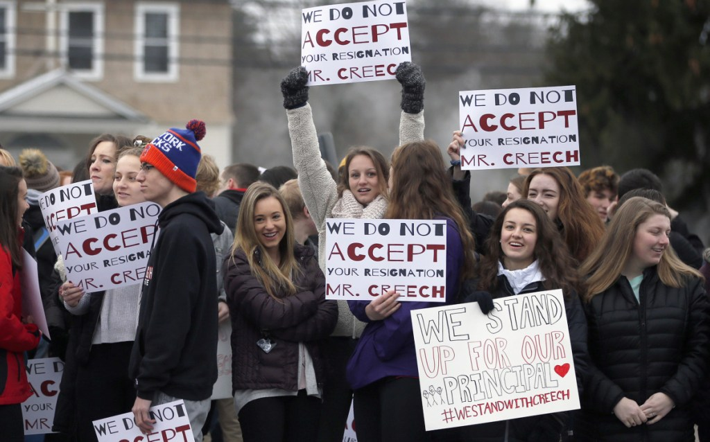 Scarborough High School students hold placards during a rally in February in support of Principal David Creech, who resigned amid controversy over school start times.
