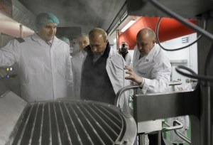 In this pool photo taken on Sept. 20, 2010, businessman Yevgeny Prigozhin, right, shows Russian President Vladimir Putin, center, around his Concord Catering factory outside St. Petersburg, Russia. One of those indicted in the Russia probe is a businessman with ties to Russian President Vladimir Putin. AP WIREPHOTO