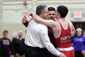Sanford's Sam Anderson celebrates with head coach Brent Coleman (left) and assistant coach Paul Rivard after winning his second straight state title. JASON GENDRON PHOTOGRAPHY