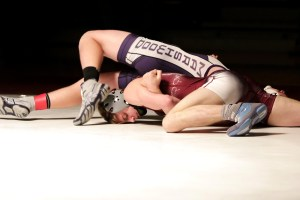 Noble's Josh Cote picks up a pin during a match this season. JASON GENDRON PHOTOGRAPHY