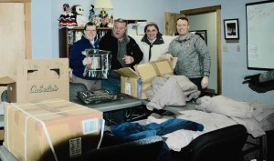 Director Amy Marcotte, Mobile Vet Center tech Gerry Short, Office Manager Jeanette Clukey  and social worker Dan Bricker, all of the Sanford Vet Center, check out the items offered to homeless veterans and others during the Point in Time homeless survey last month. Items included winter coats, warm hoodies, gloves and mittens, socks and blankets from Cabelas and Army Barracks, both of Scarborough, Patriot Riders of America Chapter One contributed $2,000. COURTESY PHOTO