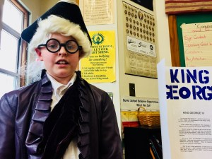 C.K. Burns third-grader Faye Collins recites her speech about King George III during the school's was museum project at the Saco school on Friday. LIZ GOTTHELF/Journal Tribune